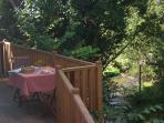 breakfast on the decked terrace overlooking the stream