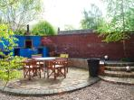 South Facing walled garden with built in BBQ