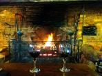 Enjoy a glass of wine in a cosy atmospheric pub