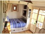 Inside - your comfy double bed with a view straight out into the field.