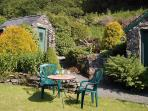 The rear garden is with hills as a backdrop