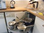 Kitchen is well equipped with quality cookware
