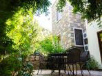 Olive tree provides a shady area off the kitchen terrace