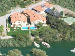 Two and three bedroom semi-detached villas with 60m2 shared floodlit pool in 3,500m2 landscaped gard