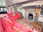 Lounge with feature stone inglenook fireplace for a cosy night in
