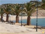 Walkway along Luz Beach