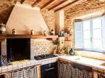 The main kitchen with wooden oven