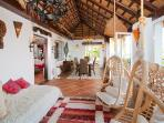 Sun room / indoor dining room under African thatched roof