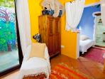 Colourful children's bedroom with wall murals and its own bathroom