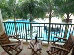 Balcony overlooking pool bar