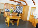 Beamed open plan kitchen/dining area with under floor heating
