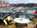 Views from terrace over looking the colourful Marina
