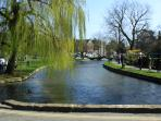 Idyllic Bourton on the Water with the River Windrush running through its heart