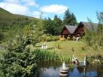 View of chalets, garden and duck pond