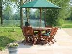 Patio and patio table with seating for up to 6. Great for enjoying a BBQ!