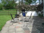 The patio area equipped with large gas BBQ and fire pit! A sun trap in the afternoon and evening!