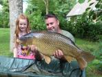 Cottage guest Nathan Dufossee and his lovely daughter Madison very happy with this 28lb Common Carp