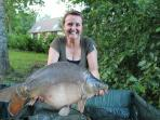 Cottage guest Mel Adams is cleaqarly very happy with this 18lb Mirror from the Cottage swim