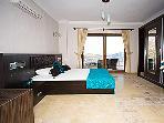 en-suite bedroom lwith access to walk-around balcony