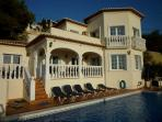 The villa which has blinds come out from the terrace for shade around the pool.