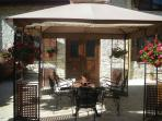 Private courtyard with garden furniture & gazebo