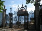 Hand-crafted wrought iron gates to Villa Bonfiglio on the lakeshore by Taverna Bleu