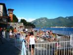 Sala's beach and enclosed swimming area set into the lake at the end of Via Rocco