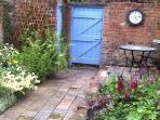 Blooming walled garden at the River House Holiday Cottage Chester