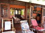 Veranda with rocking chair and sun loungers