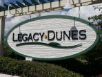 new sign for Legacy Dunes at the Rt. 192 entrance.