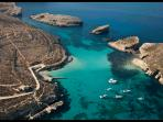 Catch a foot ferry from Mgarr to Blue Lagoon, Comino. The water is spectacular for swimming!
