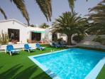 Christophe's pool and patio area showing the astroturf to protect your feet in the heat