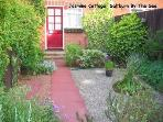 The rear garden is fenced and patio garden furniture is provided.