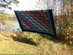 Sleep under line-dried Nova Scotia quilts
