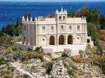 Church of Santa Maria del Isola cut into the rock overlooking the sea in Tropea