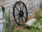 This old plough wheel is just one old artefact adorning the outside of the cottage.