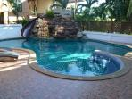 Pool, jacuzzi, waterfall and water slide