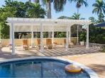 Swim in your private pool, sunbathe on the deck or relax under the Royal Palm trees