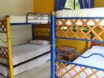 Bedroom 2: 5 single beds