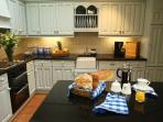 Large country style kitchen with pine table for everyone to enjoy long lazy breakfasts together