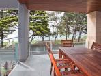 balcony overlooking the sea with barbeque and outdoor setting to seat 8