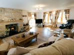 The sitting room with log burner
