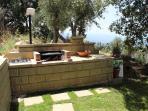 Barbecue fisso con cucina esterna