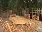 Private patio overlooking the river Colwyn with seating for six and a BBQ