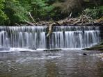 A short walk away and you will find a water fall and 100's of acres of woods to explore!