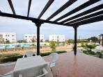 Relax on your terrace while overlooking the pool