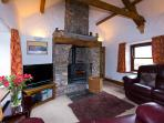 Log burner, comfortable leather sofas, cosy lounge with TV, DVD and lovely views across farmland.