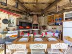 BBQ with outdoor dining by pool terrace