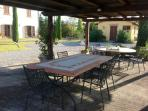 Chestnut Pergola with Terracotta Tables and Chairs and bbq area to eat 'al fresco'