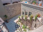 View into eStudio UNO and stairway to eStudio DOS and rooftop terrace
